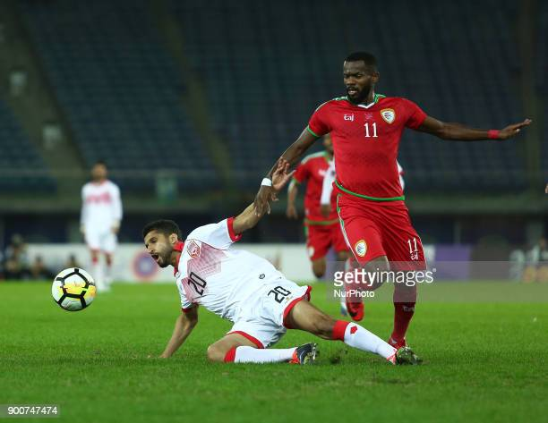 Oman's Saad Suhail alMukhaini fight for the ball during the 2017 Gulf Cup of Nations semifinal football match between Oman and Bahrain at the Sheikh...