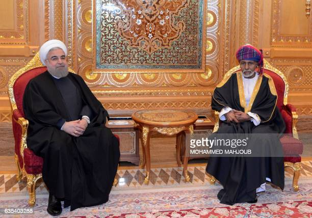 Oman's Sultan Qaboos bin Said and Iranian President Hassan Rouhani meet following the latter arrival in Muscat on February 15, 2017. / AFP / MOHAMMED...