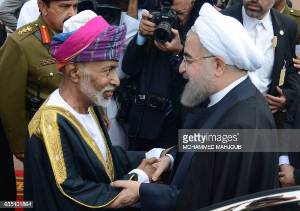 Oman's Sultan Qaboos bin Said greets Iranian President Hassan Rouhani upon the latter arrival in Muscat on February 15 2017 / AFP / MOHAMMED MAHJOUB