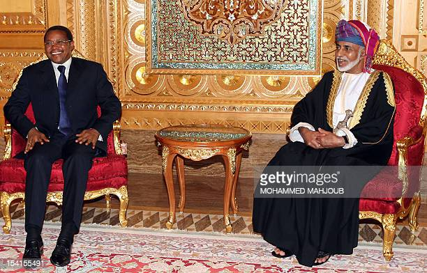 Oman's Sultan Qaboos bin Said meets with Tanzania's President Jakaya Kikwete upon the latter's arrival in Muscat on October 15, 2012. AFP...