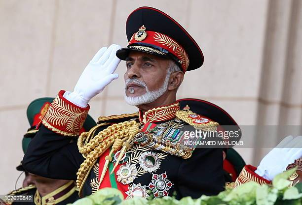 Oman's Sultan Qaboos bin Said salutes at the start of a military parade at a stadium in Muscat on the occasion of the Sultanate's 40th National Day...