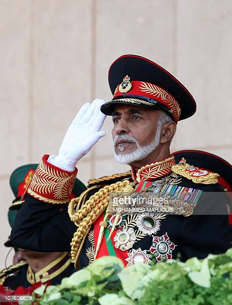 Oman's Sultan Qaboos bin Said salutes during a military parade at a stadium in Muscat on the occasion of the Sultanate's 40th National Day on...