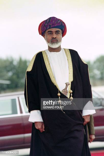 Oman's Sultan Qaboos bin Said waits for the French President François Mitterrand's arrival on January 30 1992 at the Muscat airport