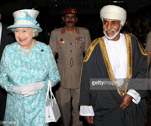 Oman's Sultan Qaboos bin Said welcomes Britain's Queen Elizabeth II upon her arrival at Muscat on November 25, 2010 following her trip to the United...