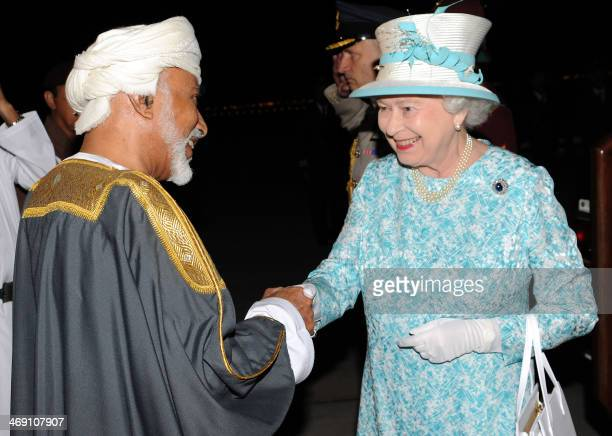 Oman's Sultan Qaboos bin Said welcomes Britain's Queen Elizabeth II upon her arrival at Muscat on November 25 2010 following her trip to the United...