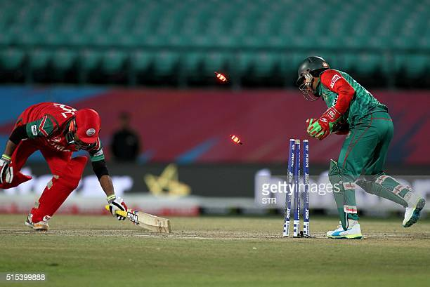 Oman's Syed Amir Ali is stumped out during the qualifying match for the World T20 cricket tournament between Bangladesh and Oman at The Himachal...