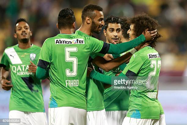Omar Abdulrahman celebrates his goal with his team mates during a friendly soccer match between Al-Ahli Saudi and Barcelona at Al-Gharrafa Stadium in...