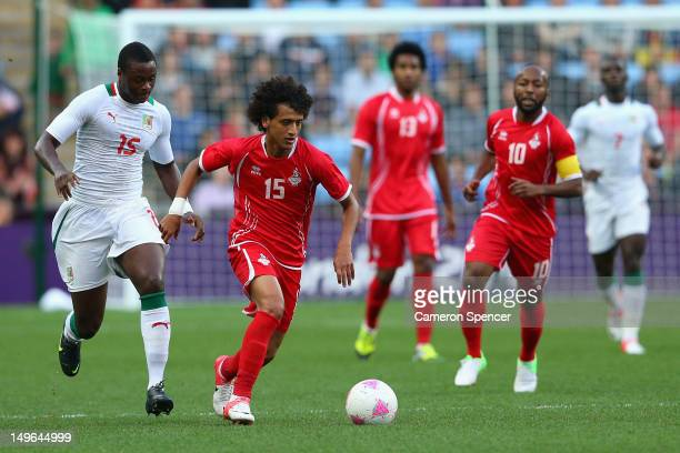 Omar Abdulrahman of United Arab Emirates dribbles the ball during the Men's Football first round Group D Match between Senegal and United Arab...