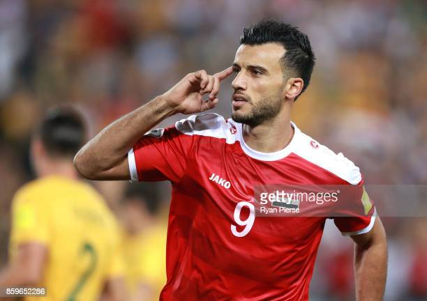 Omar Al Soma of Syria celebrates after scoring his teams first goal during the 2018 FIFA World Cup Asian Playoff match between the Australian...
