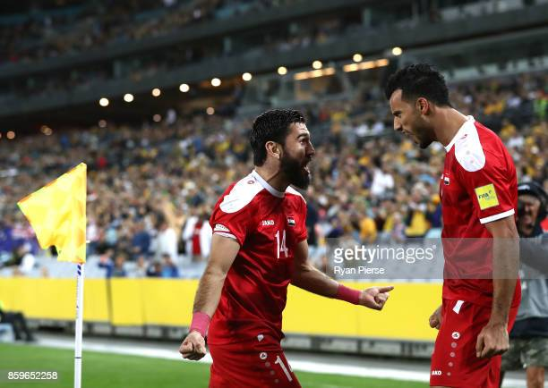 Omar Al Soma of Syria celebrates with Tamer Mohamd of Syria after scoring his teams first goal during the 2018 FIFA World Cup Asian Playoff match...