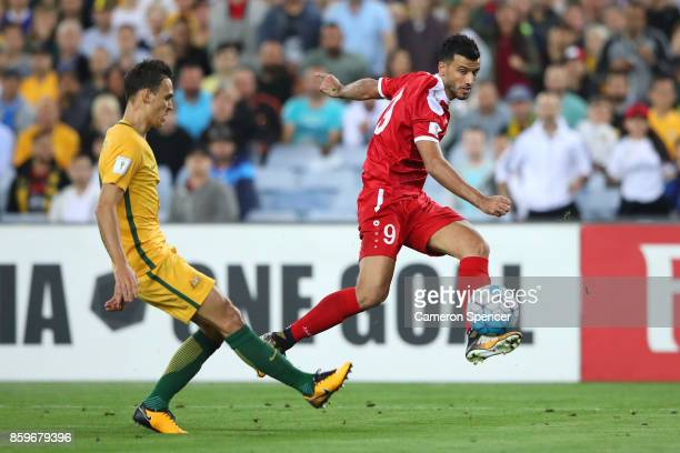 Omar Al Soma of Syria strikes the ball during the 2018 FIFA World Cup Asian Playoff match between the Australian Socceroos and Syria at ANZ Stadium...