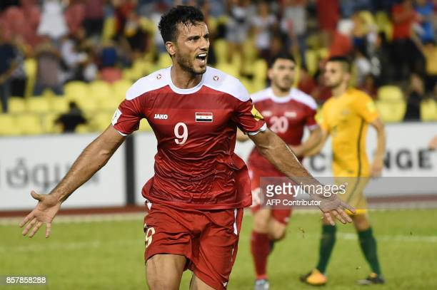 Omar Al Somah of Syria celebrates a penalty goal against Australia during the 2018 World Cup qualifying football match between Syria and Australia at...