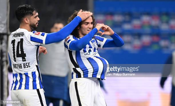 Omar Alderete and Matteo Guendouzi of Hertha BSC celebrate after scoring the 1:0 during the Bundesliga match between Hertha BSC and FC Schalke 04 at...