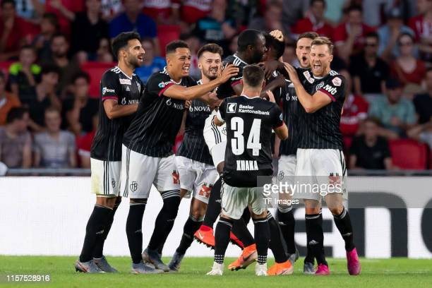 Omar Alderete of FC Basel celebrates after scoring his team's second goal with team mates during the UEFA Champions League Qualification match...