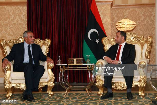 Omar alHassi speaks with Saleh alMakzom the deputy president of the General National Congress after the swearing in ceremony in Tripoli Libya on...