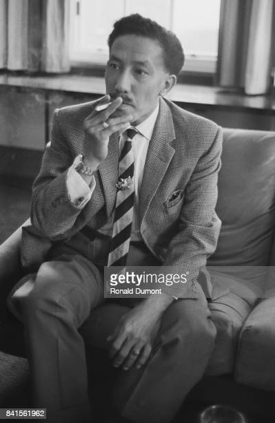 Omar Ali Saifuddien III Sultan of Brunei smokes a cigarette while staying at a hotel in London UK 13th April 1964