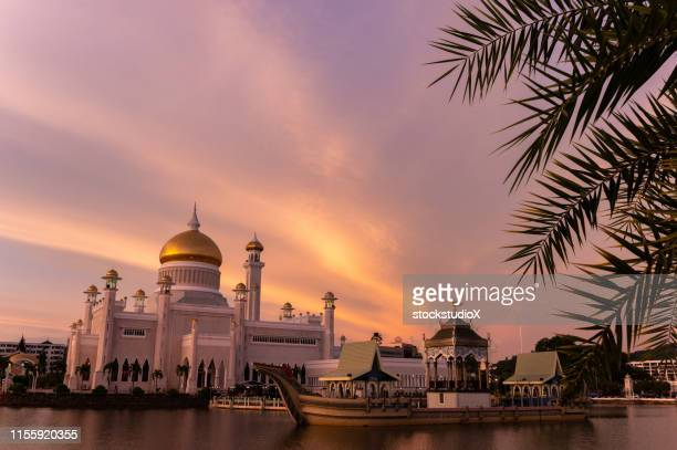 omar ali saifuddien mosque at sunset - brunei stock pictures, royalty-free photos & images
