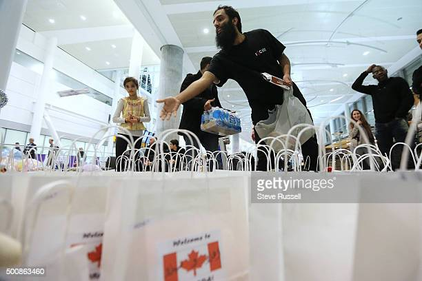 Omar Alshehri came in from Waterloo to greet refugees and add some cereal bars to a welcome package A local Toronto group put together gift bags for...