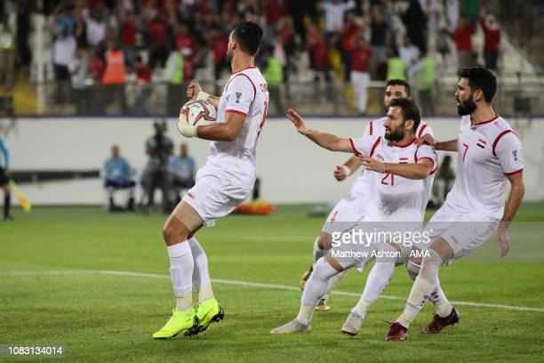 Omar Alsoma of Syria celebrates after scoring a goal to make it 2-2 during the AFC Asian Cup Group B match between Australia and Syria at Khalifa Bin...