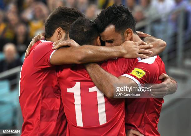 TOPSHOT Omar Alsoma of Syria is congratulated by teammates as he celebrates scoring against Australia during their 2018 World Cup football qualifying...