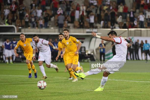 Omar Alsoma of Syria scores a goal to make it 2-2 during the AFC Asian Cup Group B match between Australia and Syria at Khalifa Bin Zayed Stadium on...