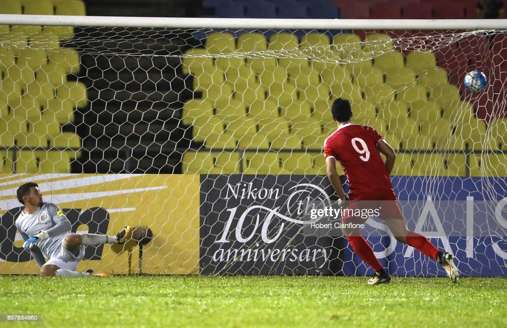 Omar Alsoma of Syria scores his penalty kick past Australian goalkeeper Mathew Ryan during the 2018 FIFA World Cup Asian Playoff match between Syria and the Australia Socceroos at Hang Jebat Stadium on October 5, 2017 in Malacca, Malaysia.
