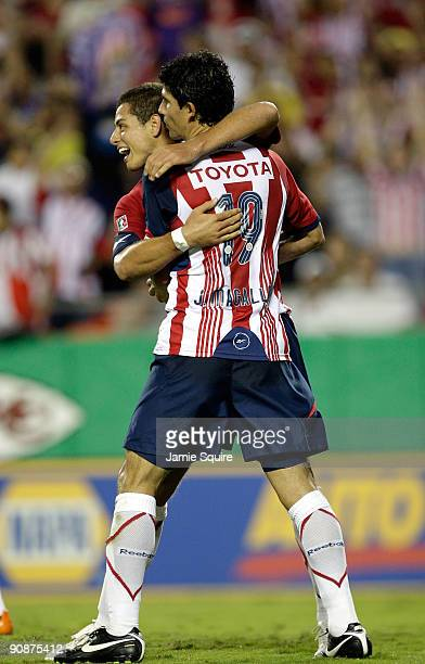 Omar Arellano and Jonny Magallon of Chivas de Guadalajara celebrate after a an owngoal by Club América during the Mexican First Division Clásico...