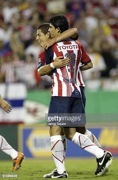 Omar Arellano and Jonny Magallon of Chivas de Guadalajara celebrate after a an owngoal by Club América during the Mexican First Division 'Clásico...