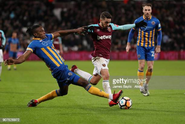 Omar Beckles of Shrewsbury Town and Manuel Lanzini of West Ham United during the Emirates FA Cup Third Round Repaly match between West Ham United and...