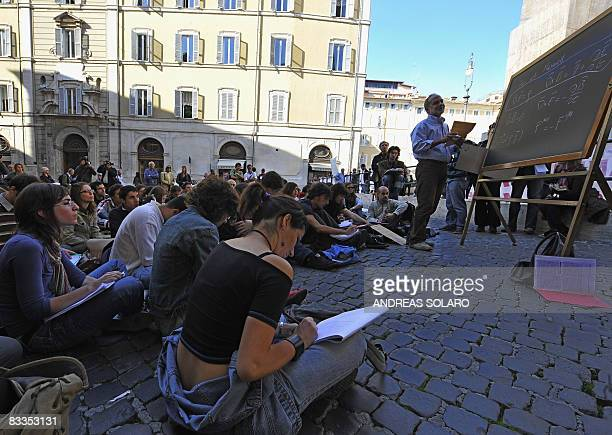 Omar Benhar a quantic mechanics' teacher of Rome's Sapienza university gives a lesson to students of the physics department outside the Italian...