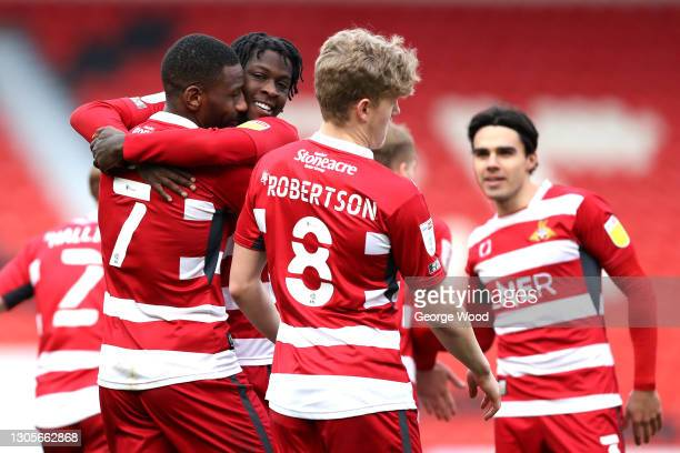 Omar Bogle of Doncaster Rovers celebrates with team mate Taylor Richards after scoring their side's second goal during the Sky Bet League One match...