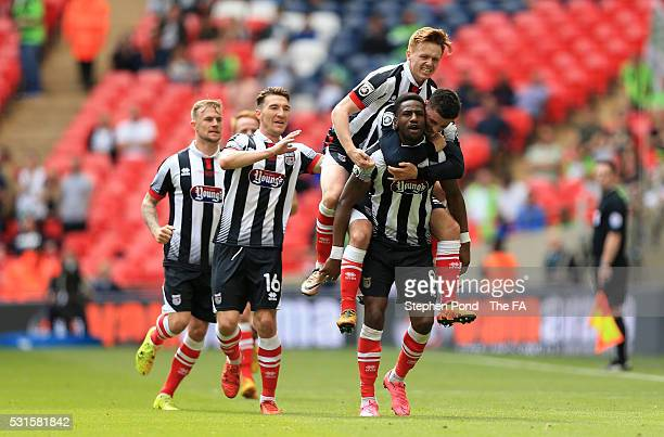 Omar Bogle of Grimsby Town is mobbed by team mates after scoring the opening goal during the Vanarama Football Conference League: Play Off Final...