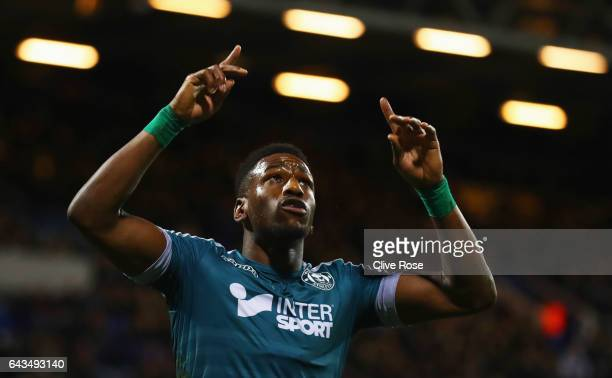 Omar Bogle of Wigan Athletic celebrates as he scores their first goal from a penalty during the Sky Bet Championship match between Queens Park...
