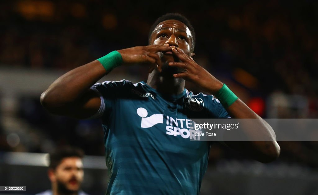 Omar Bogle of Wigan Athletic celebrates as he scores their first goal from a penalty during the Sky Bet Championship match between Queens Park Rangers and Wigan Athletic at Loftus Road on February 21, 2017 in London, England.