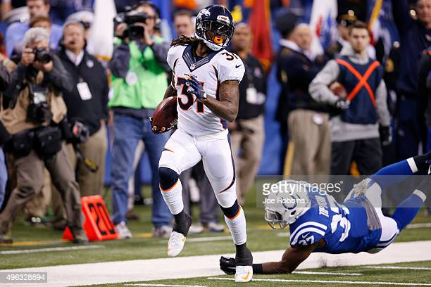 Omar Bolden of the Denver Broncos returns a punt 83 yards for a touchdown against the Indianapolis Colts in the second quarter of the game at Lucas...