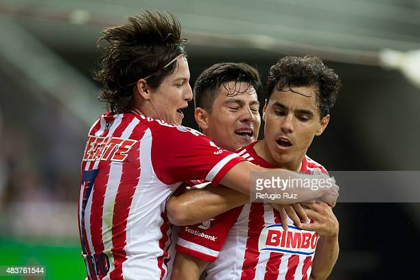 Omar Bravo celebrates with teammates after scoring the second goal of his team during a 4th round match between Chivas and Morelia as part of the...