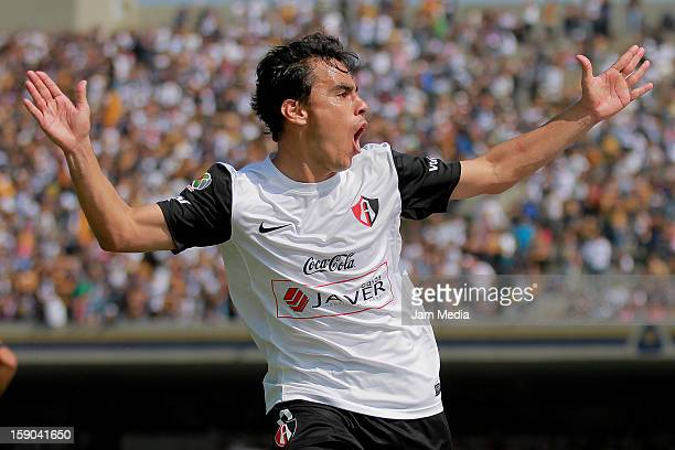 Omar Bravo of Atlas celebrates a goal against Pumas during a match between Pumas v Atlas as part of the Clausura 2013 Liga MX at Olimpico Stadium on...