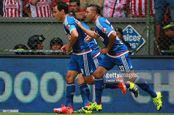 Omar Bravo of Chivas celebrates with his teammates after scoring the first goal of his team during a 5th round match between Toluca and Chivas as...