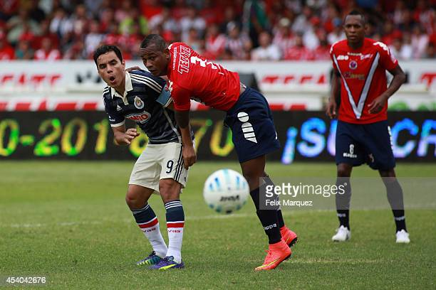 Omar Bravo of Chivas de Guadalajara is pushed by Leiton Jimenez of Veracruz during a match between Veracruz and Chivas as part of 6th round Apertura...