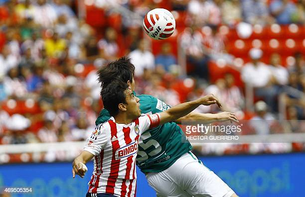 Omar Bravo of Chivas vies of the ball with Ignacio Gonzalez of Leon during their Mexican Clausura 2015 tournament football match at Omnilife stadium...