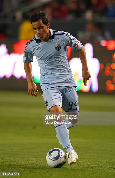 Omar Bravo of Sporting Kansas City dribbles the ball on attack during the MLS match against Chivas USA at The Home Depot Center on March 19 2011 in...