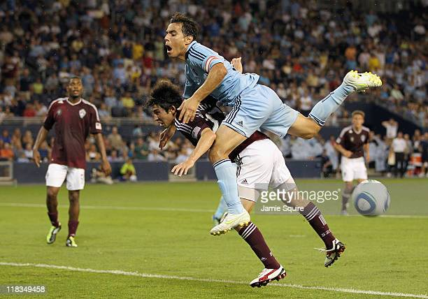 Omar Bravo of Sporting Kansas City leaps onto the back of Kosuke Kimura of the Colorado Rapids during the game on July 6, 2011 at LiveStrong Sporting...