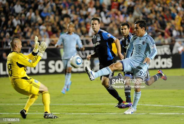 Omar Bravo of Sporting Kansas City tries to score on Jon Busch of the San Jose Earthquakes in the first half during an MLS soccer game at Buck Shaw...