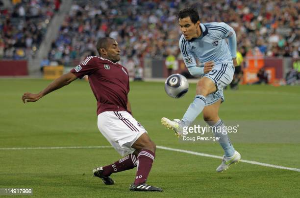 Omar Bravo of Sporting KC has a shot blocked by Marvell Wynne of the Colorado Rapids at Dick's Sporting Goods Park on May 28 2011 in Commerce City...