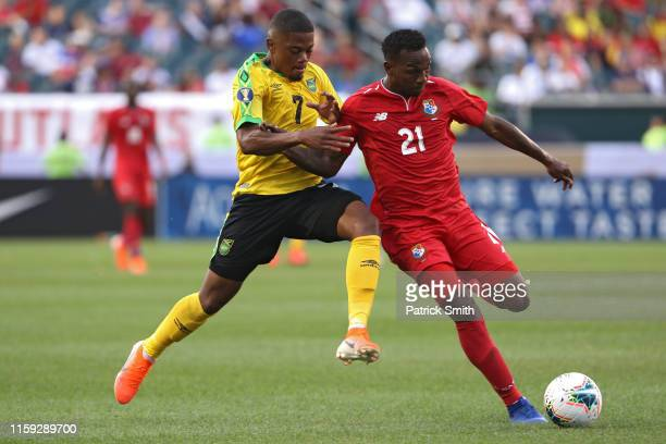 Omar Browne of Panama and Leon Bailey of Jamaica battle for the ball during the second half of the CONCACAF Gold Cup Quarterfinals match at Lincoln...