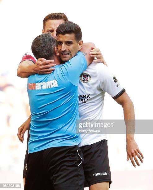 Omar Bugiel of Bromley celebrates with team mates after scoring their first goal during The Builbase FA Trophy Final between Brackley Town and...