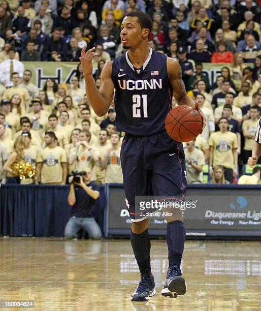Omar Calhoun of the Connecticut Huskies handles the ball against the Pittsburgh Panthers at Petersen Events Center on January 19, 2013 in Pittsburgh,...