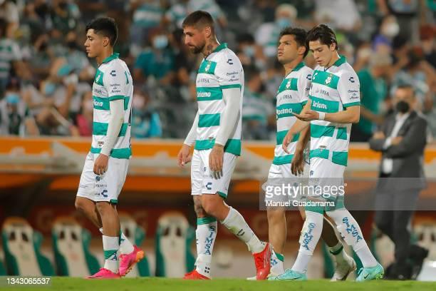 Omar Campos , Ignacio Jeraldino , Alan Cervantes and Eduardo Aguiirre of Santos react after losing the 10th round match between Santos Laguna and...