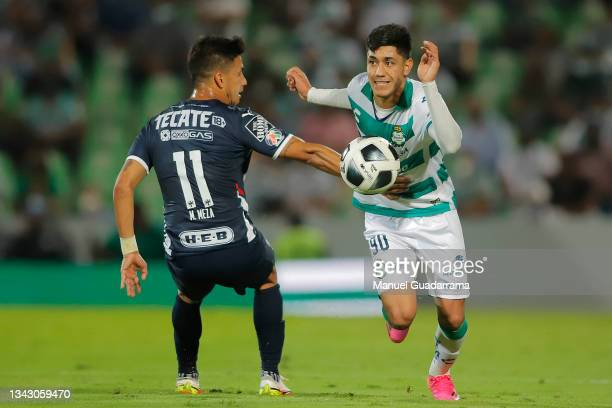 Omar Campos of Sanots fights for the ball with Maximiliano Meza of Monterrey during the 10th round match between Santos Laguna and Monterey as part...