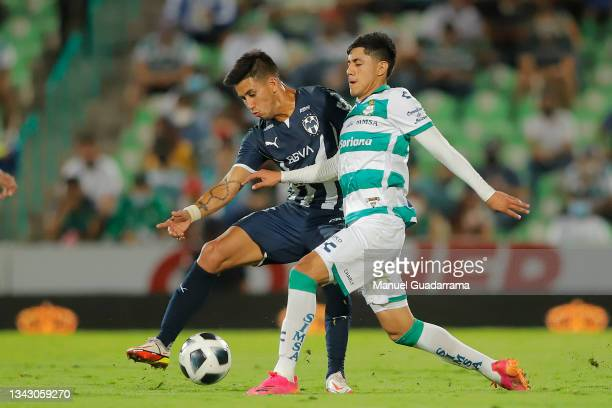 Omar Campos of Santos fights for the ball with Maximiliano Meza of Monterrey during the 10th round match between Santos Laguna and Monterey as part...